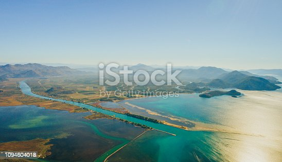 Aerial view of river comes into sea in sunny day,Neretva,Croatia