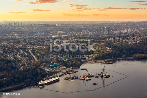Aerial view of Oil Refinery Industry in Port Moody, Greater Vancouver, British Columbia, Canada. Colorful dramatic sunset artistic render.