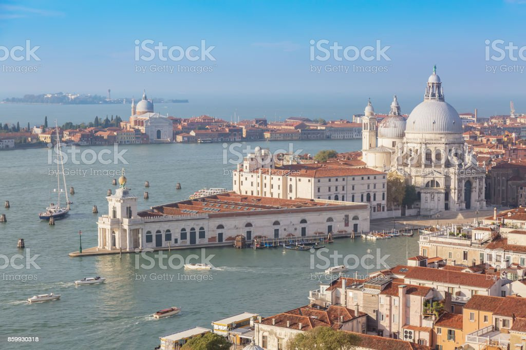 Aerial view of Venice, Santa Maria della Salute with Guidecca during early morning summer day. stock photo