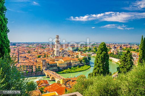 Aerial view of Verona historical city centre, Ponte Pietra bridge across Adige river, Verona Cathedral, Duomo di Verona, red tiled roofs, Veneto Region, Italy. Verona cityscape, panoramic view.