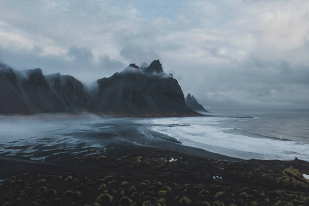 Aerial view of Vestrahorn mountains near the sea Aerial view of Vestrahorn mountains near the sea in Iceland black sand stock pictures, royalty-free photos & images