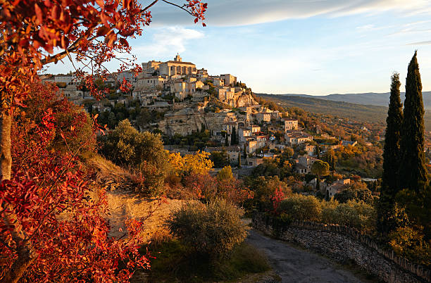 Aerial view of village in Gordes, Provence in France Gordes, Vaucluse, Provence, France on a morning in autumn. provence alpes cote d'azur stock pictures, royalty-free photos & images