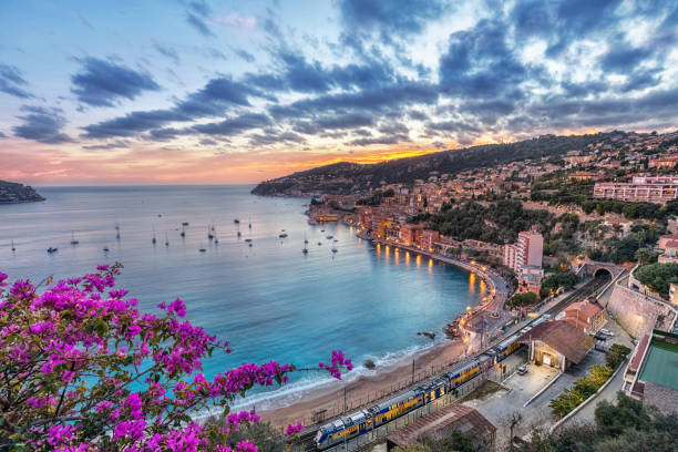Aerial view of Villefranche-sur-Mer on sunset, France Aerial view of Villefranche-sur-Mer and the bay of Villefranche on sunset, Alpes-Maritimes, France provence alpes cote d'azur stock pictures, royalty-free photos & images