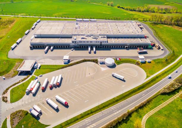 aerial view of warehouse with trucks. - prodotti supermercato foto e immagini stock