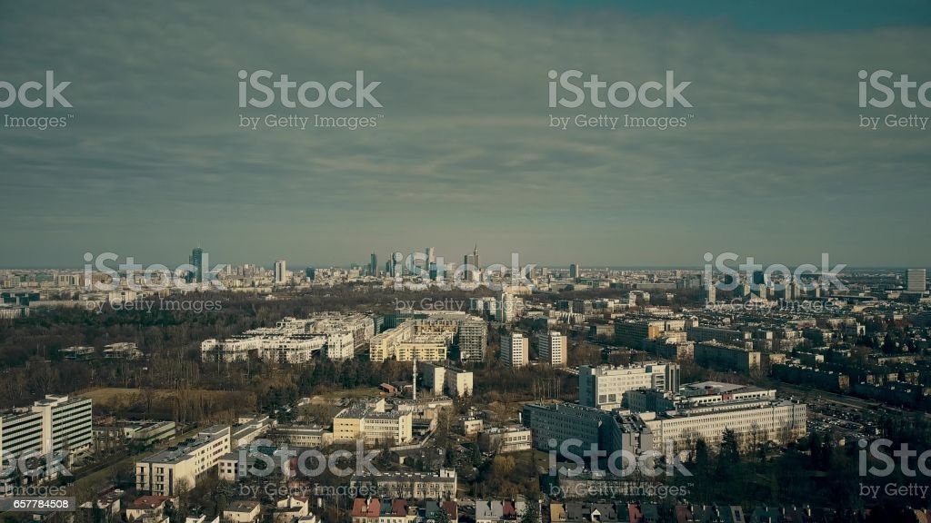 Aerial view of Warsaw suburbs and distant dowtown skyline on sunny spring day, Poland stock photo