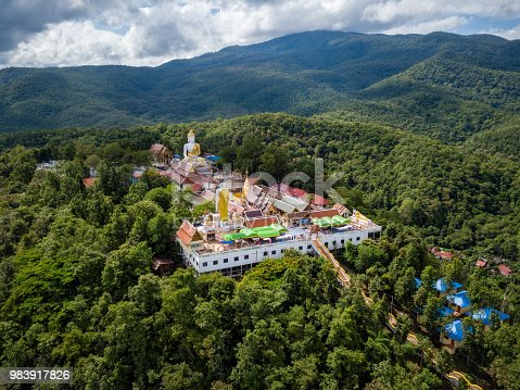 istock Aerial view of Wat Phra That Doi Kham Temple on the top of mountain in Chiang Mai, Thailand. 983917826