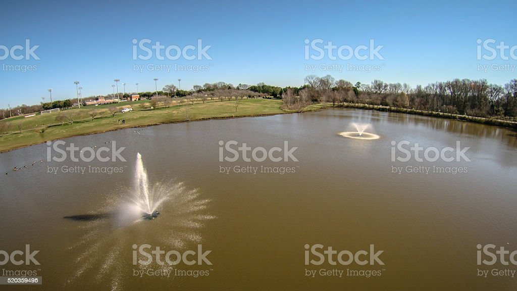 aerial view of water pond aeration fountain stock photo