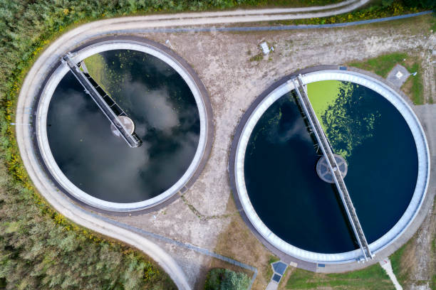 Aerial View of Water Purification Plant Aerial view of a sewage treatment plant, Bavaria, Germany sewage treatment plant stock pictures, royalty-free photos & images