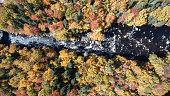 DSLR  Aerial picture of a small waterfall in Autumn season. The Neilson River is a beautiful river in Saint-Raymond, Portneuf, Quebec, Canada