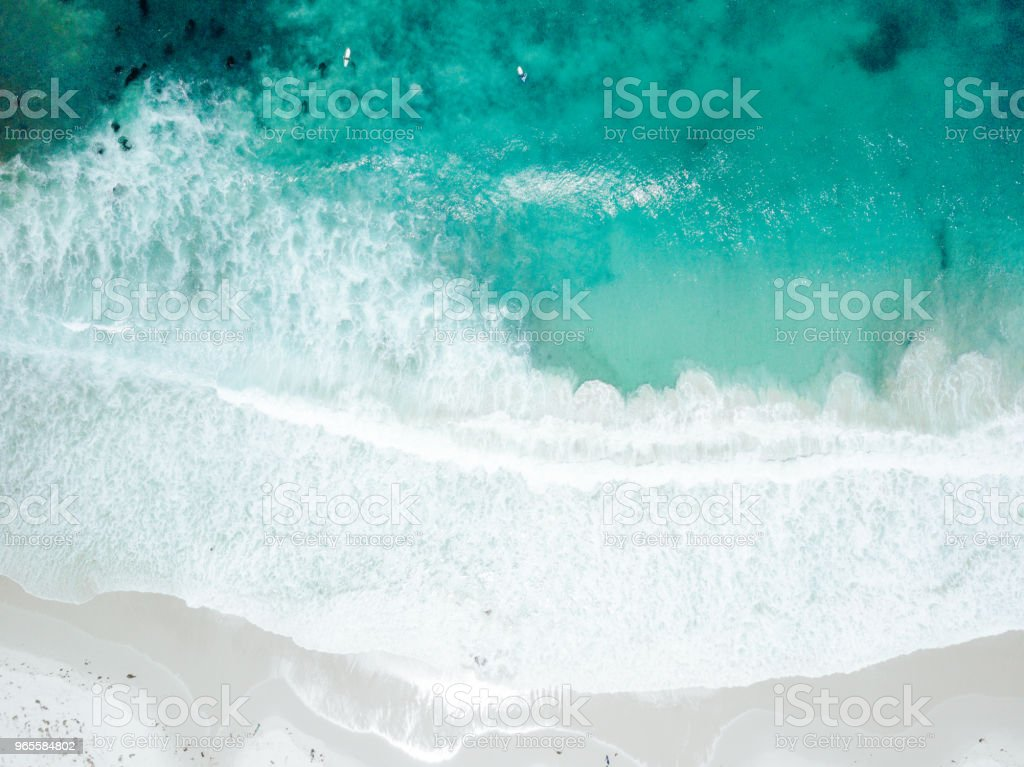 Aerial View Of Waves Crashing On Sandy Beach Stock Photo - Download