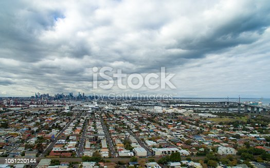 Aerial view of West Gate Bridge and Melbourne city from Yarraville on cloudy day
