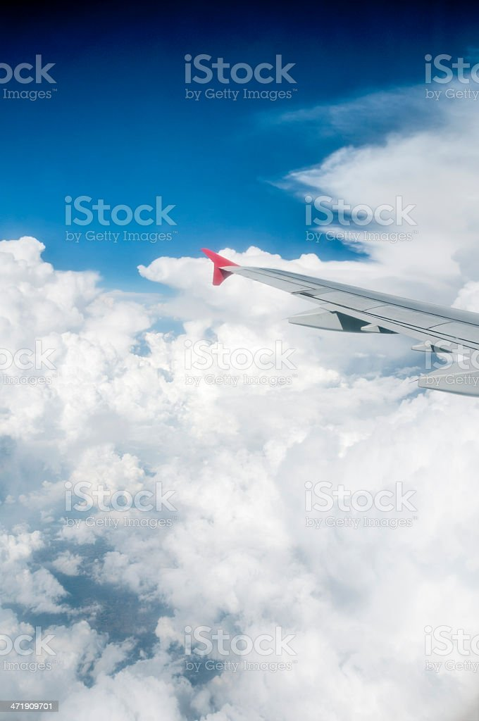 Aerial View Of White Clouds From An Aeroplane Window royalty-free stock photo