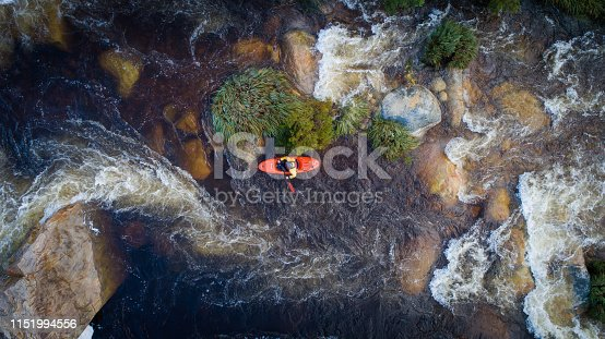 istock Aerial view of White water kayaker in a stream in South Africa 1151994556