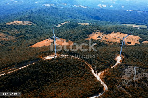Aerial view of wind turbine in fall.