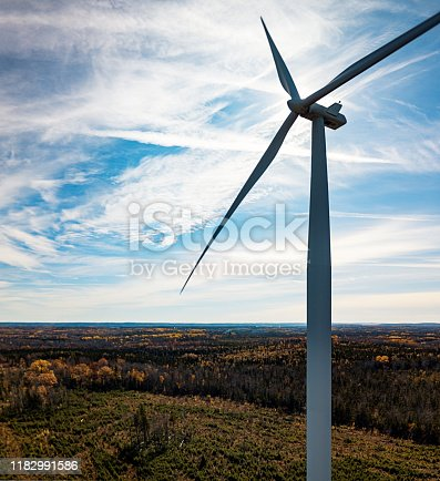 Aerial drone view of a wind turbine.