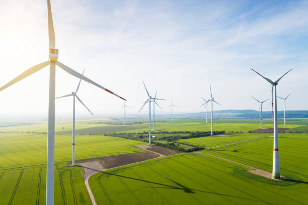 Aerial view of wind turbines and agriculture field stock photo