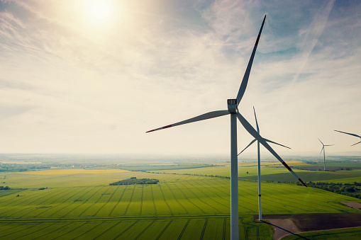 Aerial view of wind turbines and agriculture field