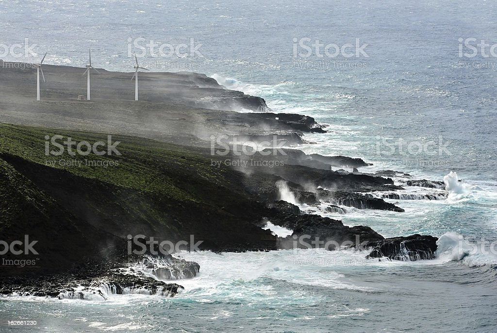 aerial view of wind turbines at a d rocky coastline royalty-free stock photo