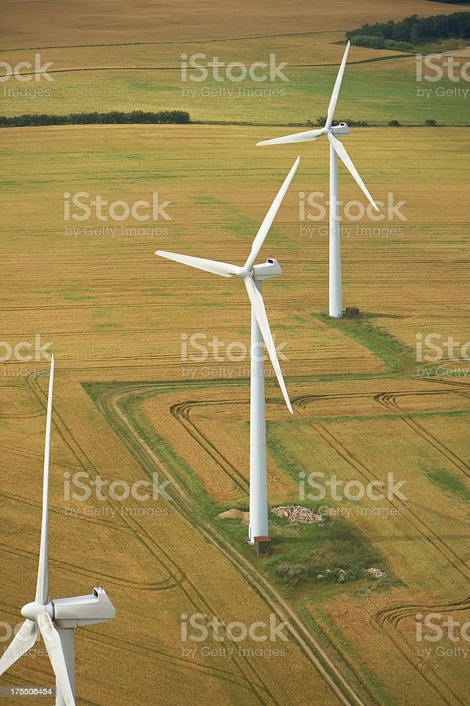 Aerial view of windmills in fields royalty-free stock photo