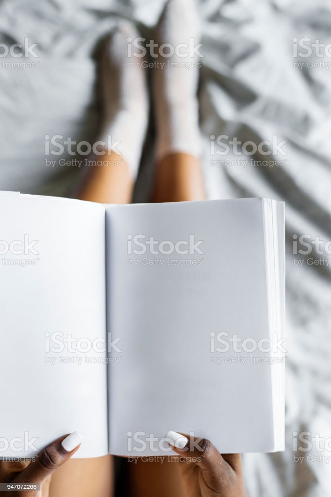 Aerial view of woman holding blank diary stock photo