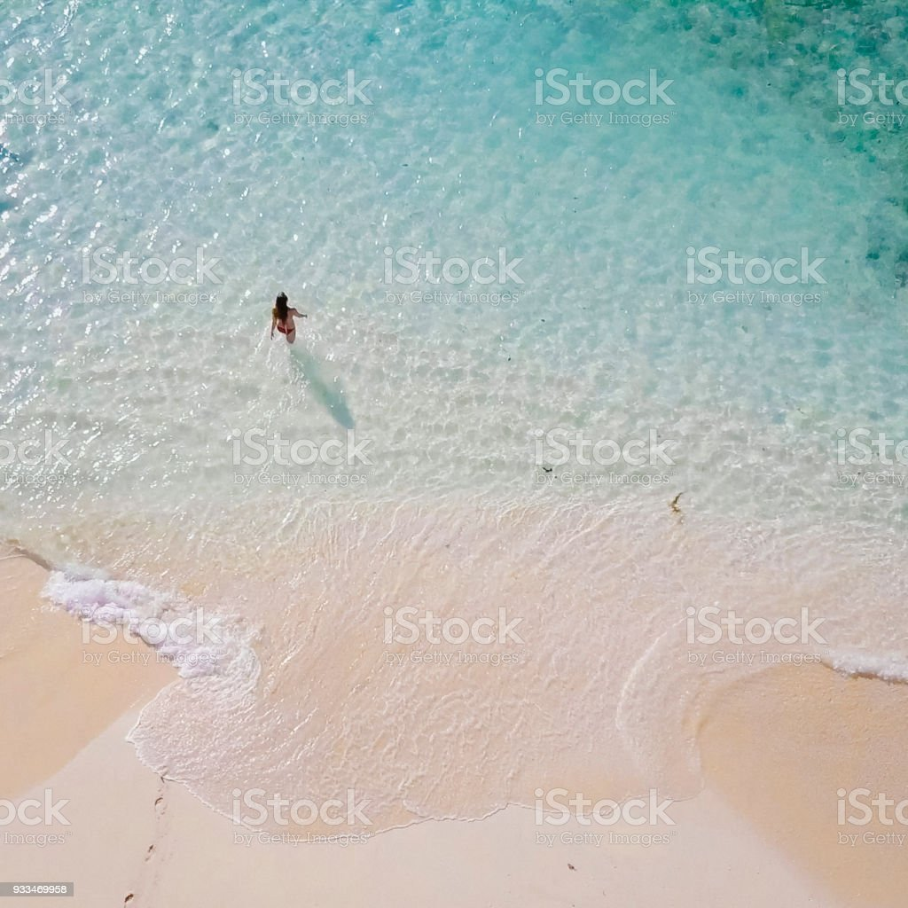 Aerial view of woman in shallows stock photo