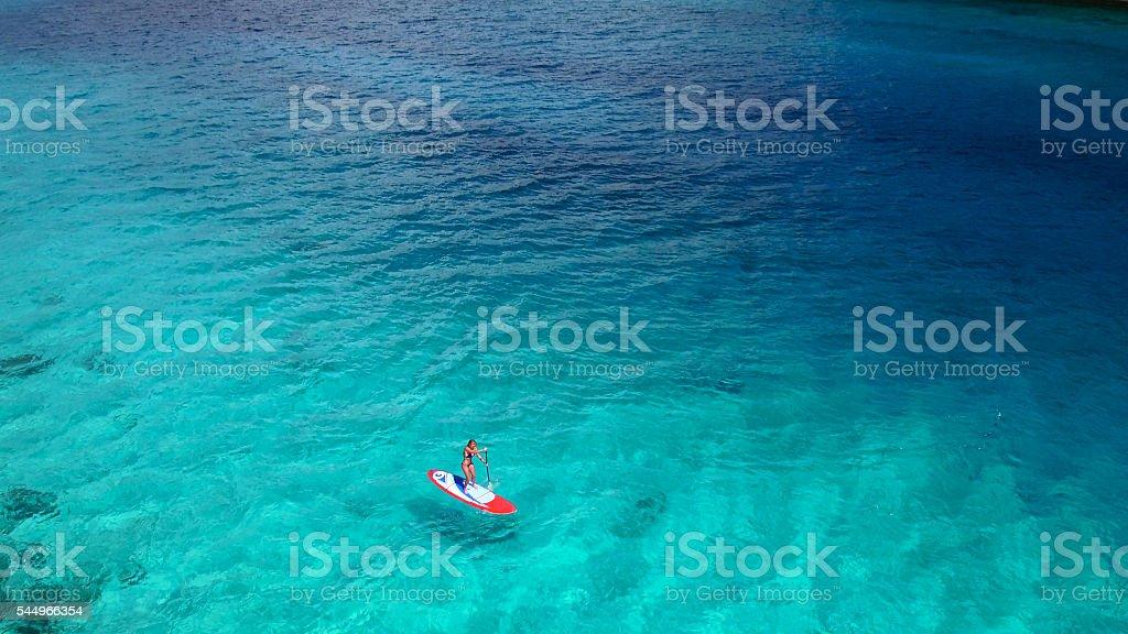 Aerial view of woman on paddleboard stock photo