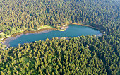 istock Aerial view of wooden Lakehouse inside the forest in Bolu Golcuk National Park.Bolu Aerial Photo, Turkey. Shooting with drone 1332071118