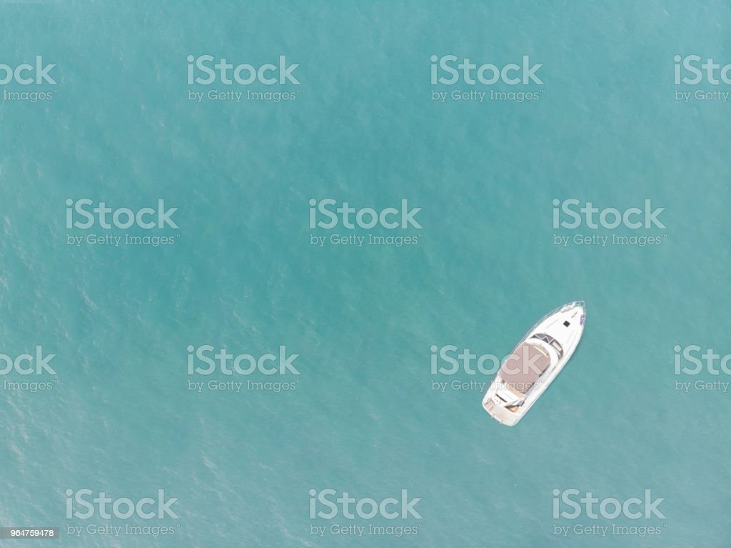 Aerial view of yacht on blue ocean with blank space royalty-free stock photo