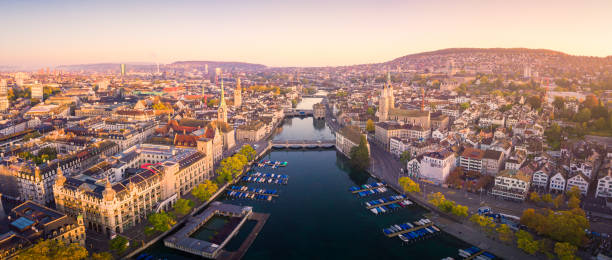 Aerial view of Zurich and River Limmat, Switzerland Aerial panoramic cityscape view of Zurich and River Limmat, Switzerland fraumunster stock pictures, royalty-free photos & images