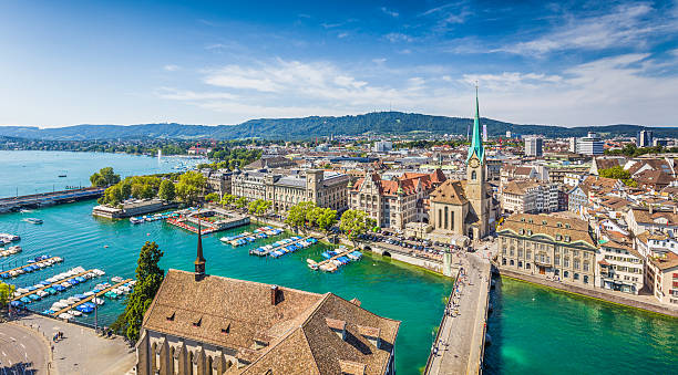 Aerial view of Zurich with river Limmat, Switzerland Aerial view of Zurich city center with famous Fraumunster Church and river Limmat at Lake Zurich from Grossmunster Church, Canton of Zurich, Switzerland. fraumunster stock pictures, royalty-free photos & images