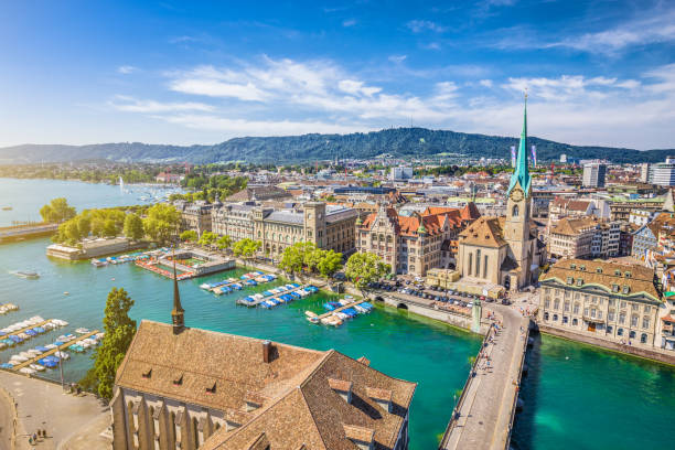 Aerial view of Zurich with river Limmat, Switzerland Aerial view of Zurich city center with famous Fraumunster Church and river Limmat at Lake Zurich from Grossmunster Church, Canton of Zurich, Switzerland fraumunster stock pictures, royalty-free photos & images