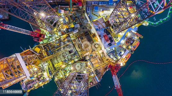 Aerial view offshore jack up rig  at night, Offshore oil rig drilling platform.