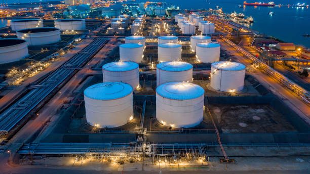 Aerial view oil and gas terminal storage tank farm,Tank farm storage chemical petroleum petrochemical refinery product, Business commercial trade fuel and energy transport by tanker vessel. stock photo