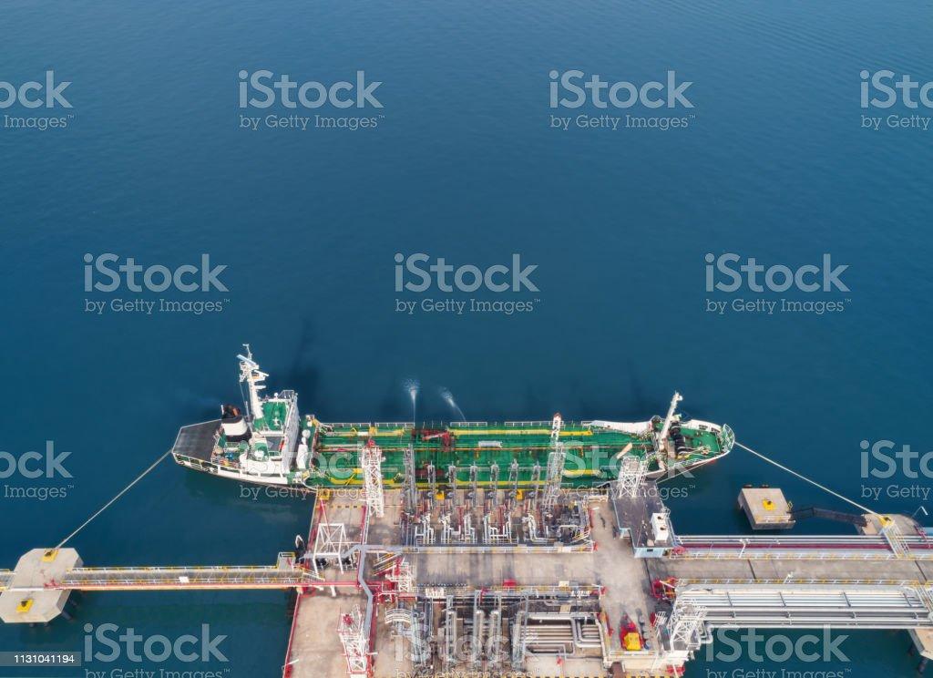 Aerial view Oil ship tanker at refinery bridge loading oil for...