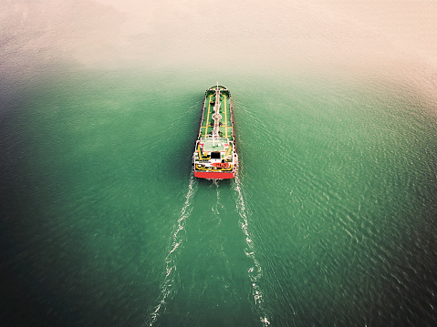 Aerial view Oil ship tanker carier oil from refinery on the sea.