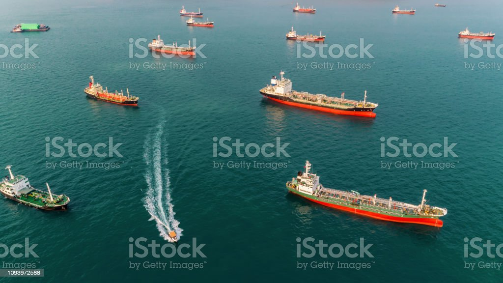 Aerial view Oil ship tanker park in the sea wait for unload oil to...