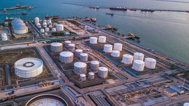 Aerial view oil terminal is industrial facility for storage of oil and petrochemical products ready for transport to further storage facilities. stock photo