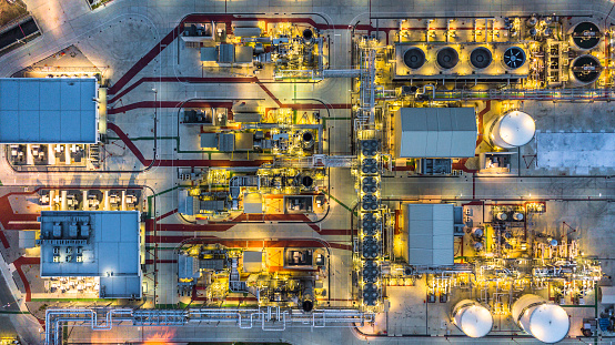 Aerial view Petrochemical plant at night, Oil refinery plant at night.Aerial view oil terminal is industrial facility for storage of oil and petrochemical products ready for transport to further storage facilities.