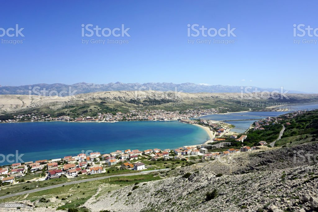 Aerial view on beautiful turquoise bay in front of the city Pag on the Island of Pag in Dalmatia, Croatia stock photo