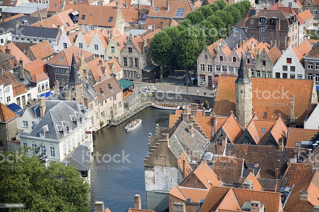 """Aerial view on Bruges """"Aerial view on the medieval city of Bruges, Belgium.At the center is the Lovers Lake (Minnewater), surrounded by ancient houses from the middle ages."""" Aerial View Stock Photo"""