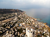 Aerial view on Haifa coastline, Israel, Mount Carmel. Travel background. Scenic panorama of seaside city at misty sea horizon background. Cityscape and seascape. Seashore of Haifa. Perspective
