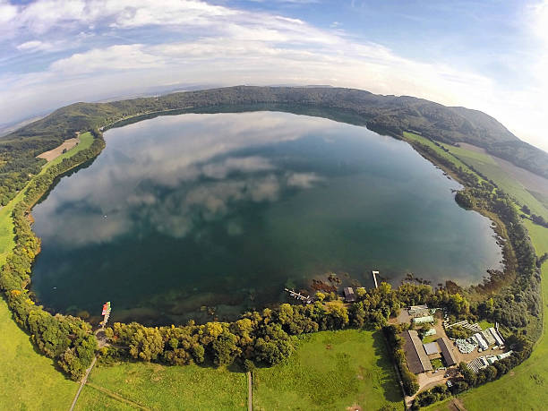 Aerial view on Laacher See Aerial view on Laacher See - a volcanic caldera lake with a diameter of 2 km in Rhineland-Palatinate, Germany volcanic landscape stock pictures, royalty-free photos & images