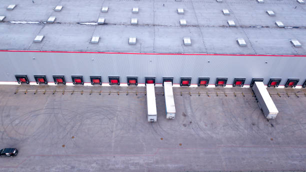 Aerial view on loading bays in distribution center. Aerial Aerial view on loading bays in distribution center. Aerial distribution center stock pictures, royalty-free photos & images