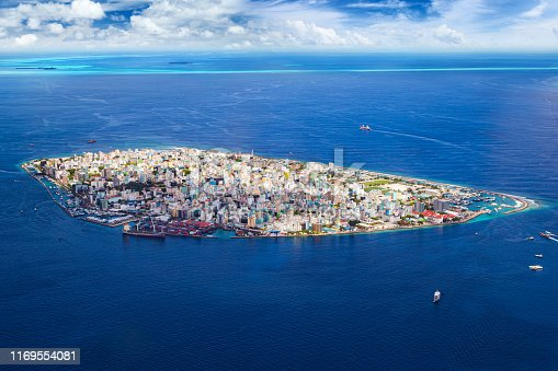 aerial view on male the capital city of maldives. overcrowded island in the indian ocean on blue ocean sea background