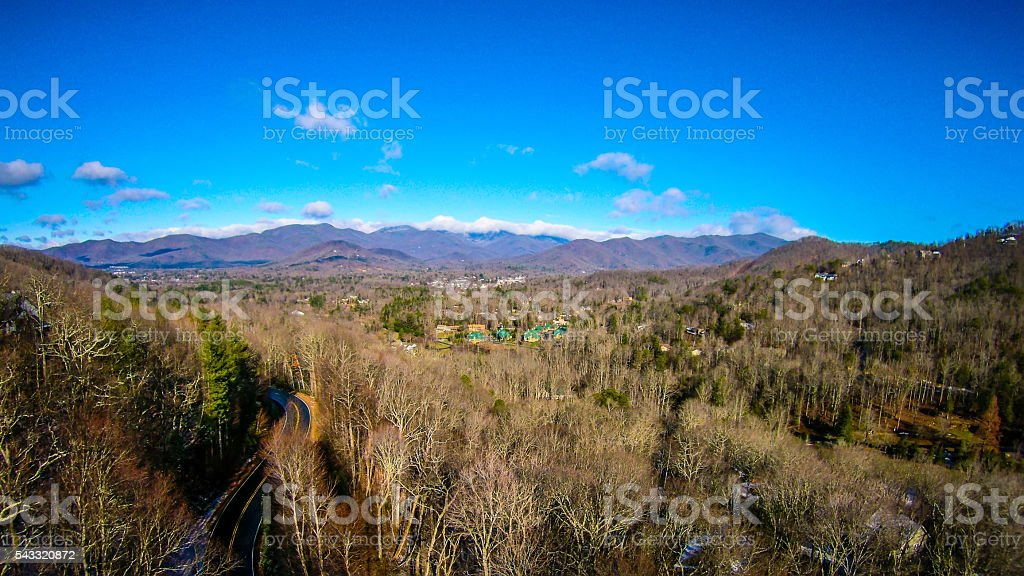 aerial view on mountains and landscape covered in snow stock photo