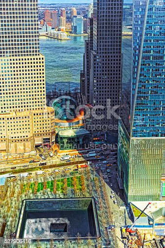 New York, USA - April 24, 2015: Aerial view on National September 11 Memorial - 9/11 - of Financial District in Lower Manhattan. It is a commemoration of the terrorist attacks on September 11, 2001