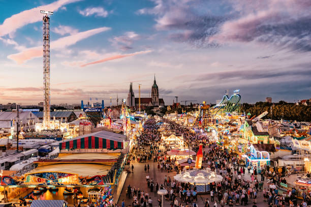 aerial view on oktoberfest in munich at sunset hour - oktoberfest stock photos and pictures