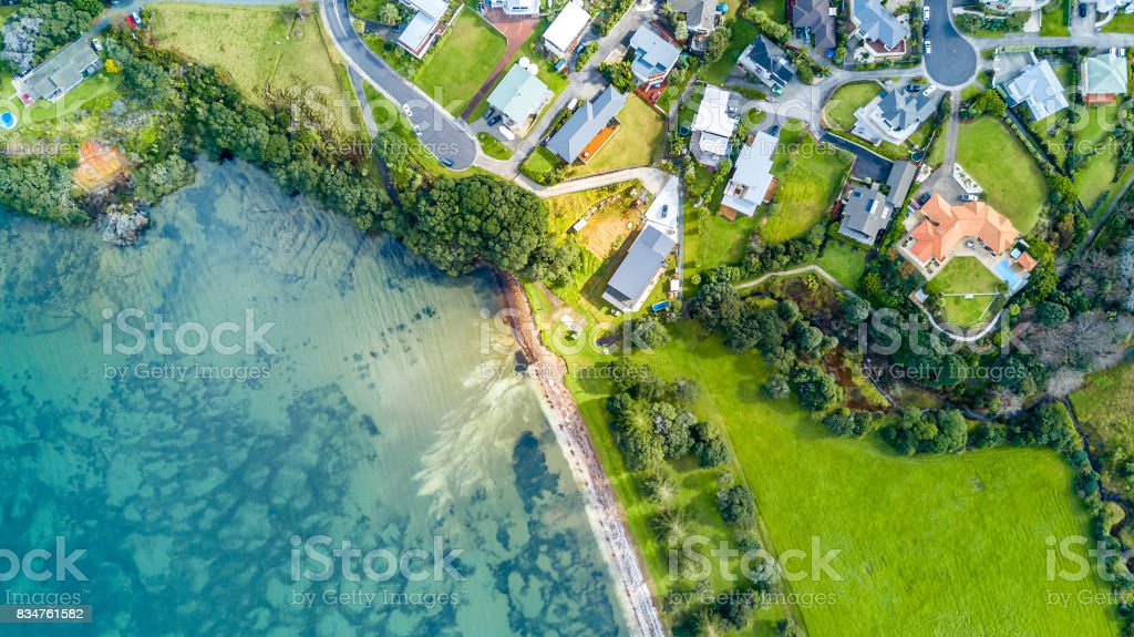 Aerial view on residential suburbs surrounded by sunny ocean harbour. Whangaparoa peninsula, Auckland, New Zealand stock photo
