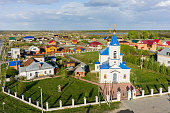 Bogandinskoe (Kilki), Russia - May 13, 2015: View at on Sacred and Ilyinsky temple from helicopter.Tyumen region. Russian text above entrance: Christ resuscitate