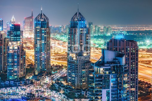 istock Aerial view on skyscrapers and highways of Dubai Marina, UAE. Multicolored travel background. 1047086626